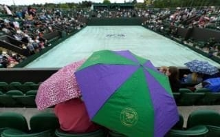Spectators with umbrellas at Wimbledon, 3 July 2017