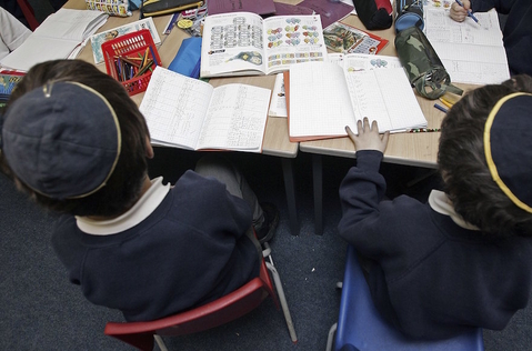 Students of the North Cheshire Jewish Primary school in Stockport, England, listening to a teacher, Dec. 7, 2006. (Christopher Furlong/Getty Images)