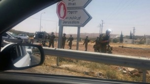 Soldiers arrive at the scene of an apparent car-ramming attack on a highway in the central West Bank on July 10, 2017 (Moked 443)