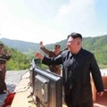 North Korean leader Kim Jong-un reacts after the test-fire of the intercontinental ballistic missile Hwasong-14